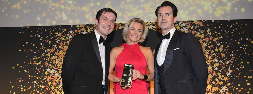 Healix collect the winning trophy at the Health Insurance Awards